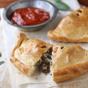 Calzones with Sausage, Mushrooms and Olives from completelydelicious.com