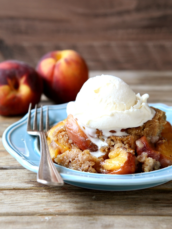 Slow Cooker Peach Cobbler | completelydelicious.com