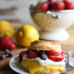 Lemon biscuit shortcakes stuffed with lemon curd, whipped cream, and fresh berries.
