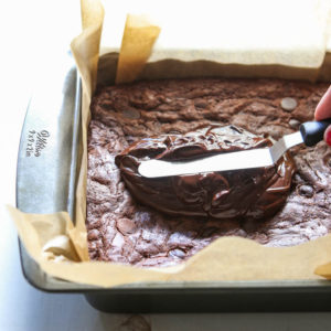 These fudge brownies are topped with chocolate ganache icing
