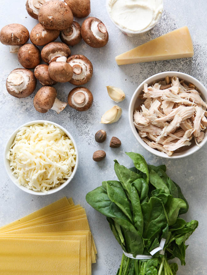 All the ingredients for chicken, mushroom, and spinach lasagna