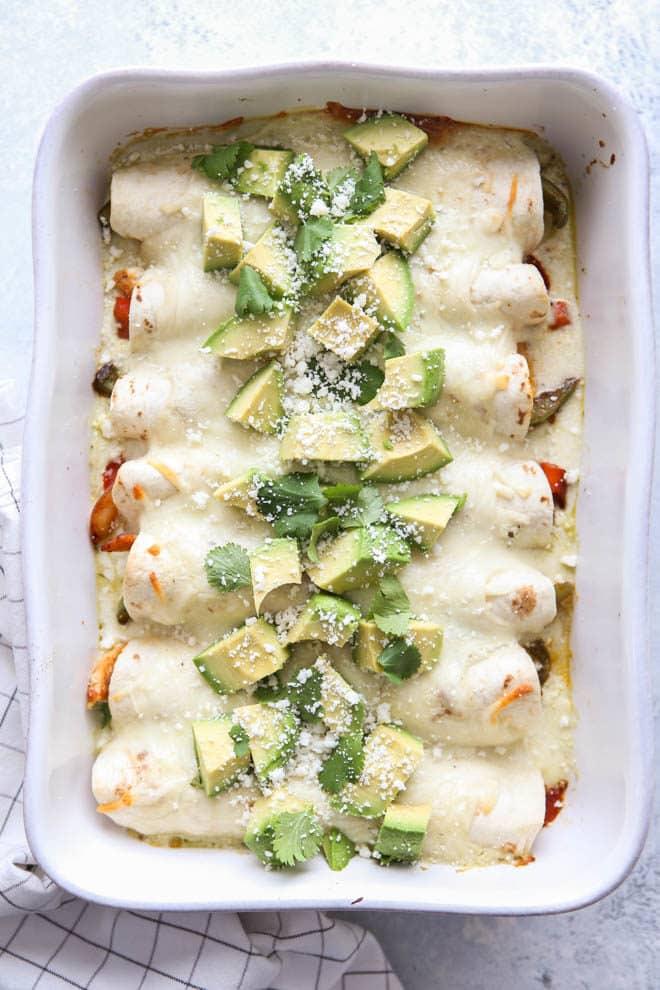 Chicken fajitas meets cheesy enchiladas in this fun main dish mashup