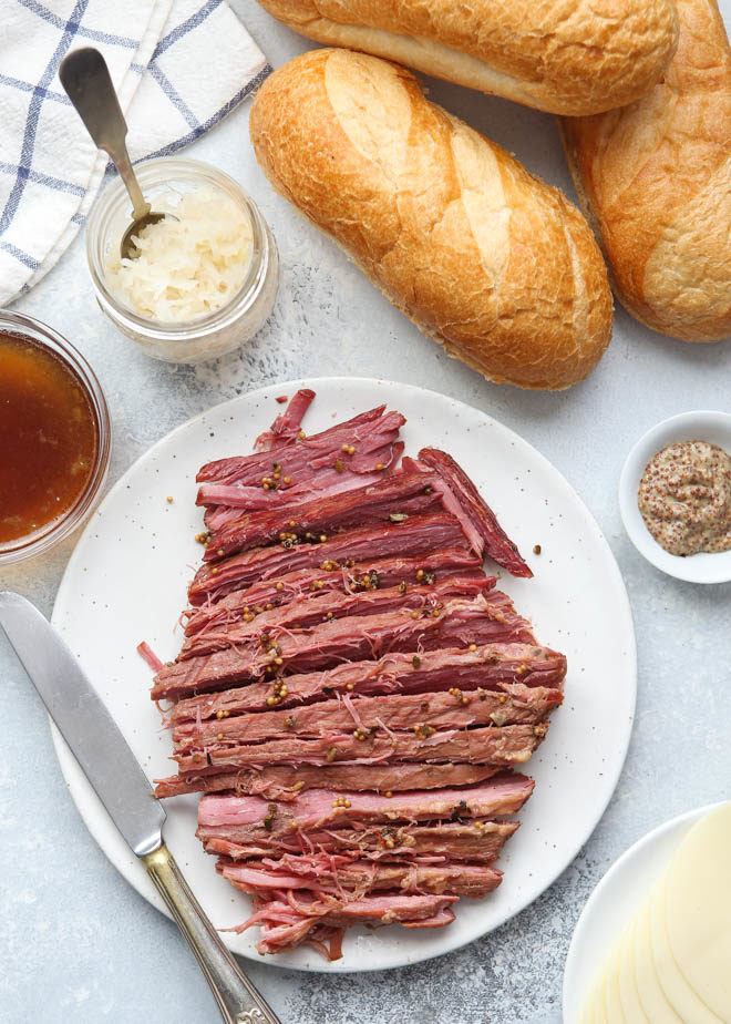 All the fixings for corned beef french dip sandwiches