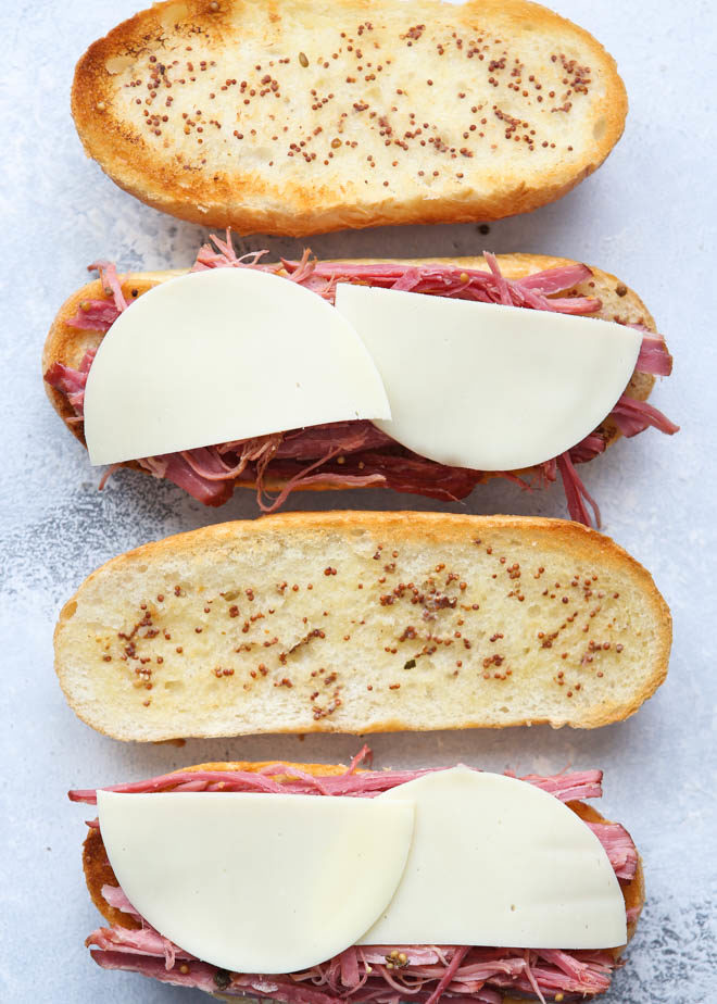 Making corned beef french dip sandwiches