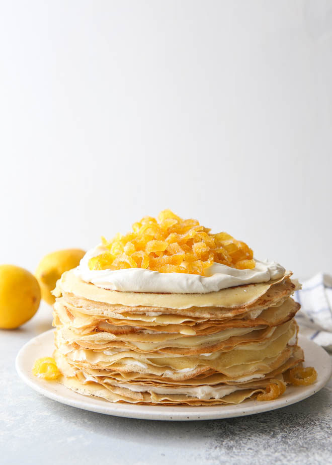 A tall tower of crepes, lemon curd and mascarpone cream