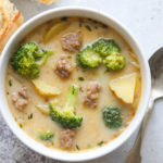 A bowl of hearty sausage, broccoli, and potato soup