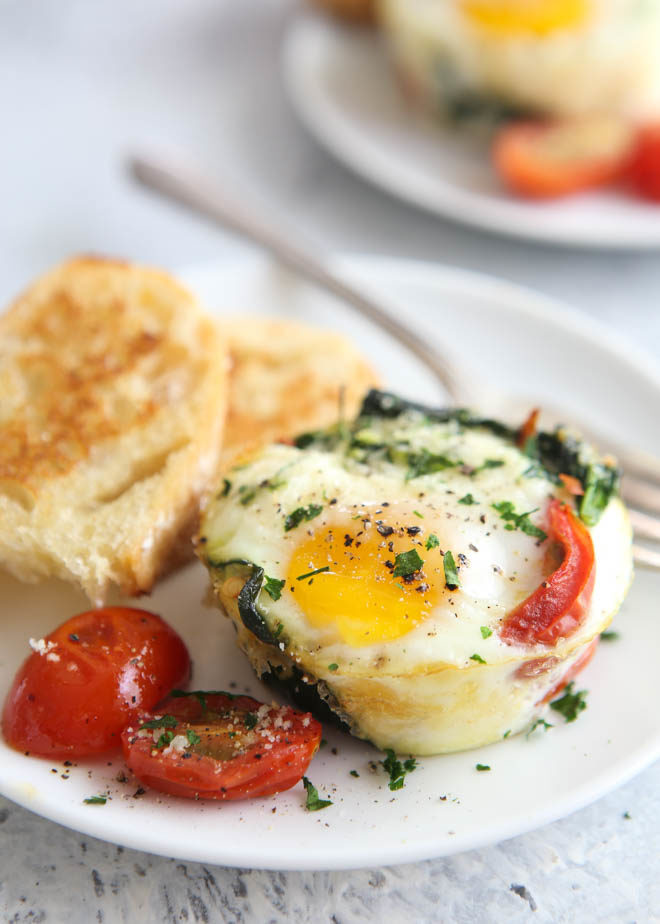 Spinach and tomato baked egg cups are great for breakfast and brunch!