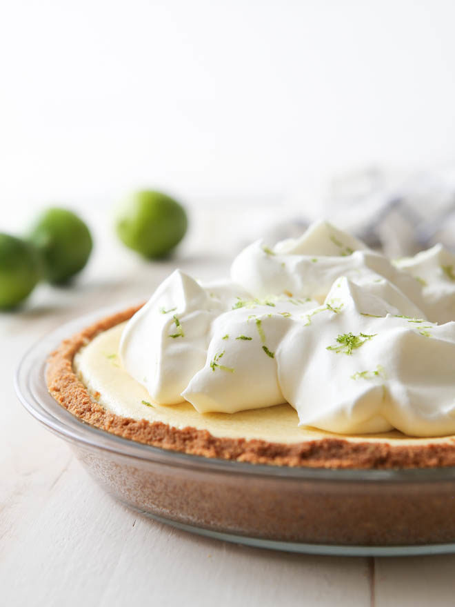 This light and creamy tequila lime pie is light, creamy, and has a bit of a fun kick!