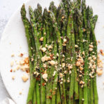 Sauteed asparagus dressed with a ginger-lime sauce and topped with peanuts