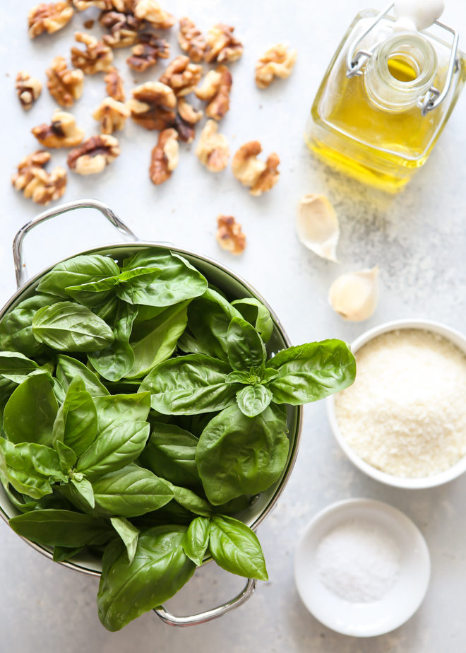 Ingredients for making basil walnut pesto