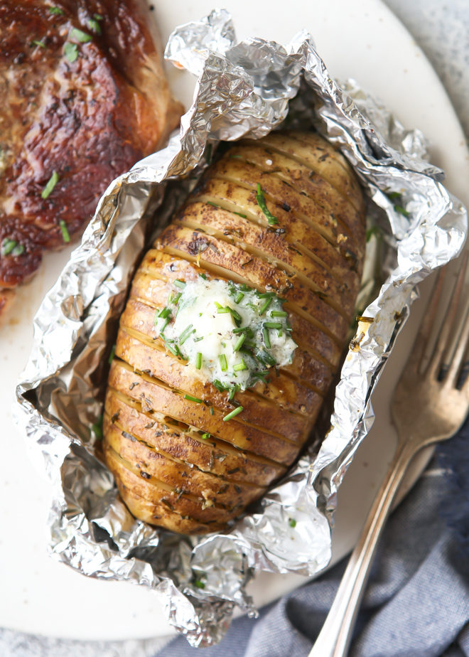 """""""Baked"""" potatoes cooked on the grill and served with chive butter"""