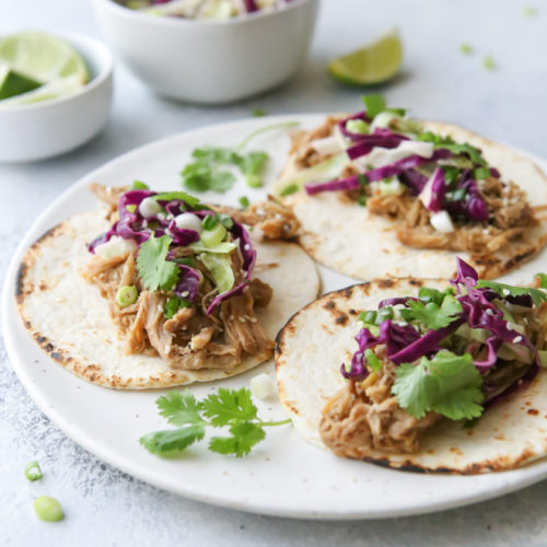 Slow cooker shredded Korean pork tacos are a great weeknight meal!
