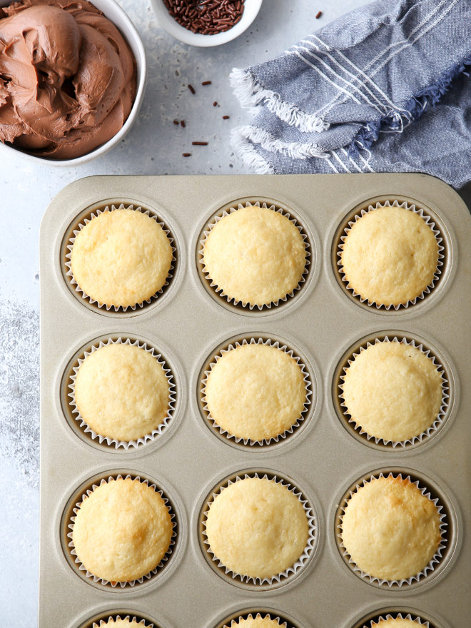 Soft and fluffy vanilla cupcakes with fudge buttercream frosting