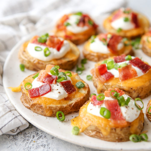 These irresistible baked potato bites are loaded up with cheese, sour cream, bacon and chives