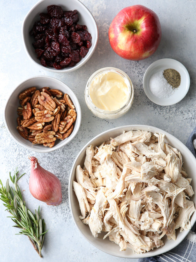 This delicious chicken salad is filled with shredded chicken, chopped pecans, diced apples, dried cherries, and a rosemary scented dressing.