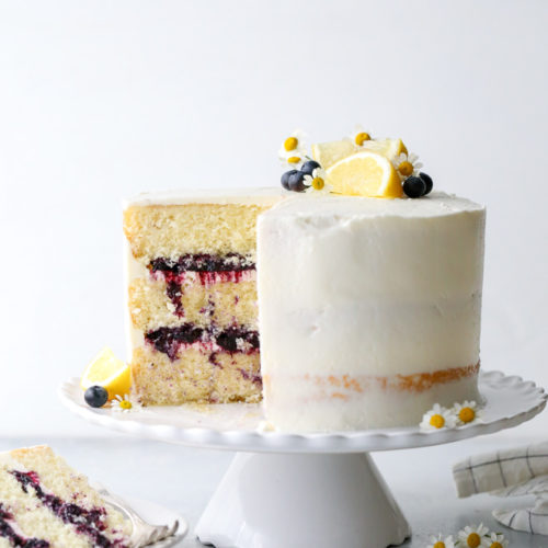 This light and tender lemon butter cake is filled with fresh blueberry preserves and frosted with silky lemon buttercream.