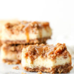 Layers of graham cracker streusel, smooth cream cheese filling, cinnamon apple chunks, and caramel drizzle make up these rich and creamy caramel apple cheesecake bars.