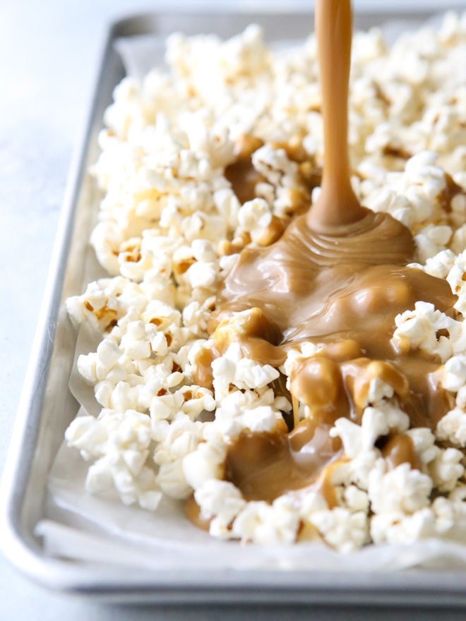 Drizzling popcorn with gooey caramel sauce