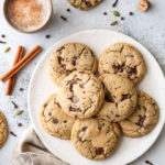 These chai spice chocolate chip cookies are thick and chewy, and loaded up with dark chocolate and warm spices like cardamom, ginger, nutmeg, cinnamon, cloves and allspice.