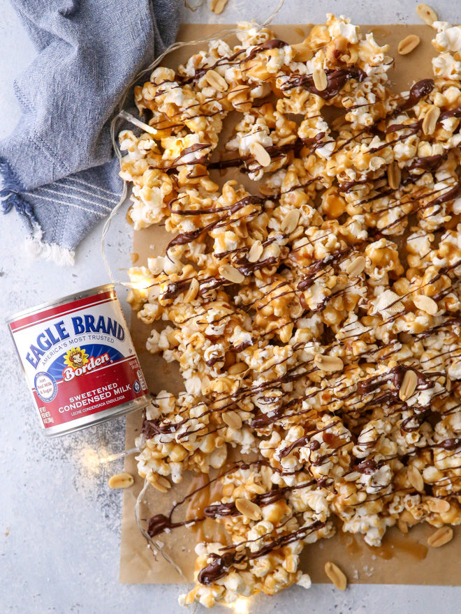 This big batch of chocolate caramel corn made with chewy caramel corn, peanuts, a drizzle of dark chocolate, and sprinkling of flaky salt is exactly what you need to get your holiday party started!