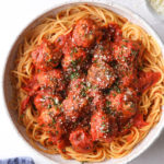 a big bowl of spaghetti with meatballs
