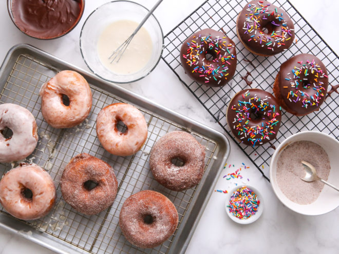 doughnuts with three toppings, cinnamon-sugar, chocolate and sprinkles, and vanilla glaze