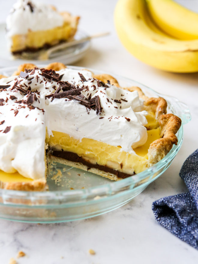 chocolate bottom banana cream pie with slices taken out so you can see the layers
